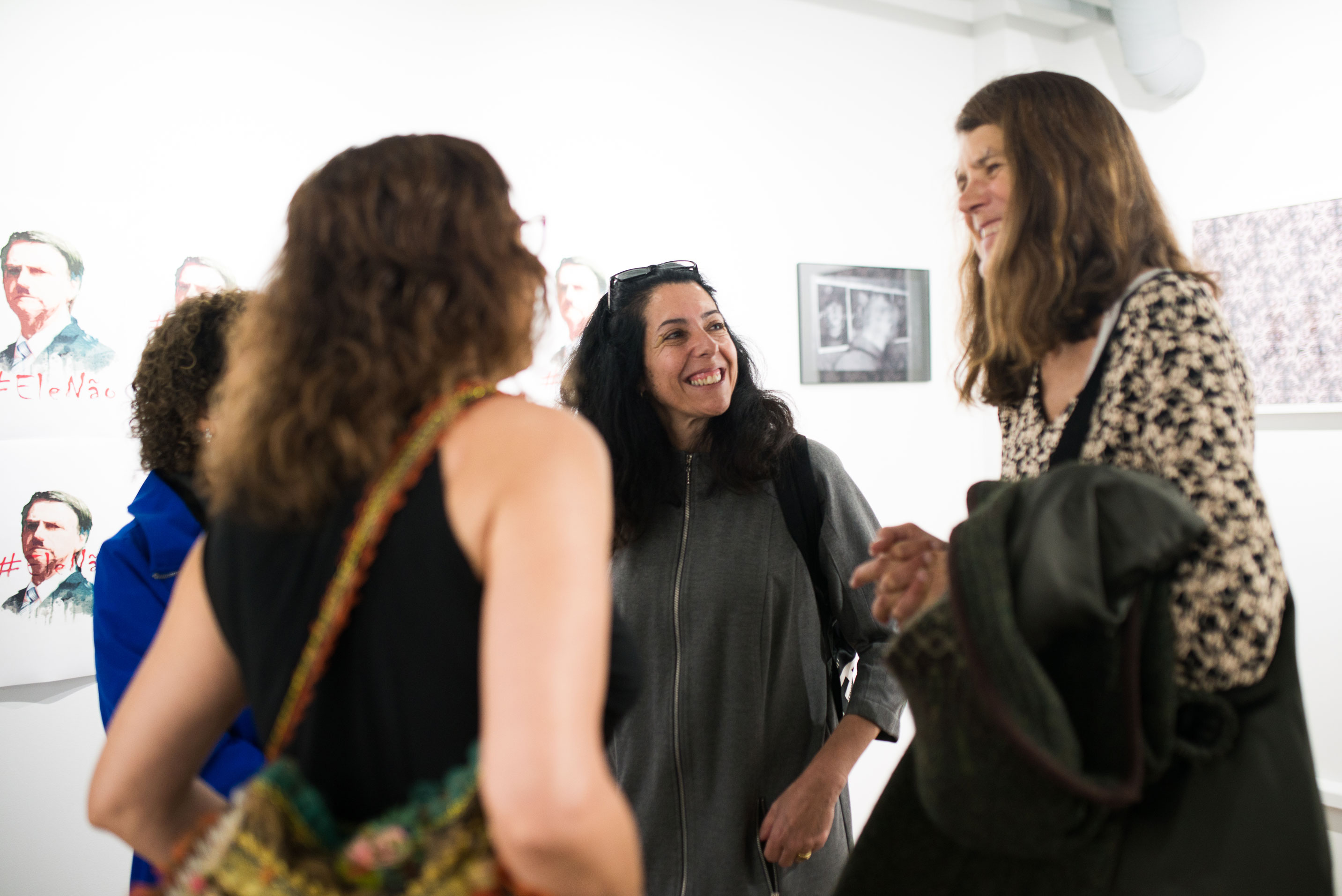 Guests during opening night of the Meandering, Inflections and Angry Camels photography exhibition — Gustavo Chams